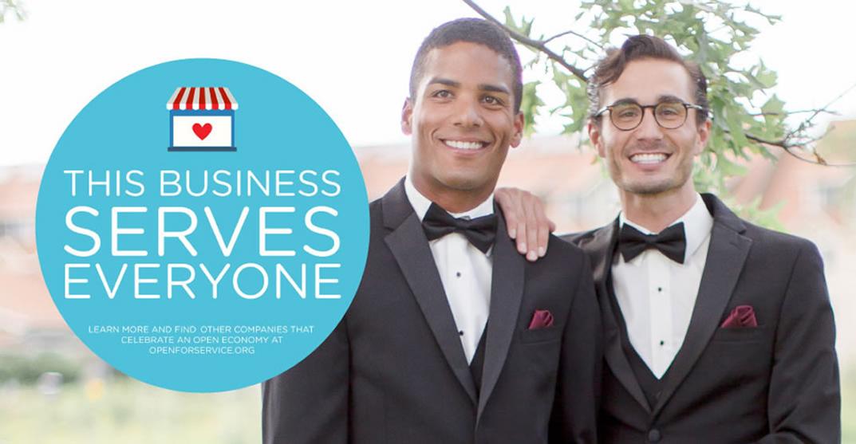 Two men wearing black tuxedoes