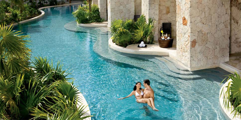 Man and woman in resort pool