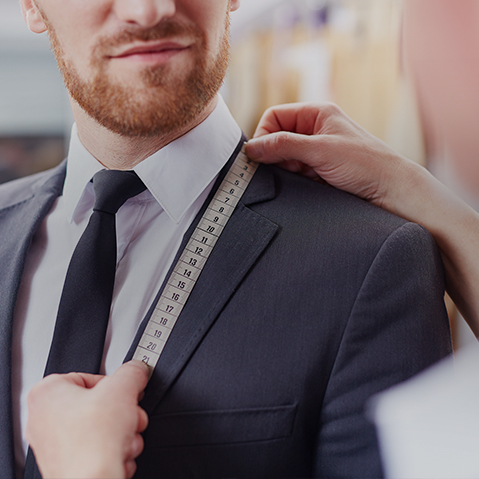 Man getting measured for a jacket