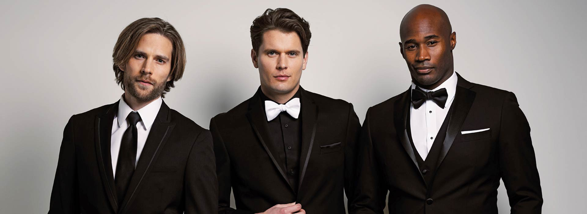 Three men in black tuxedos image