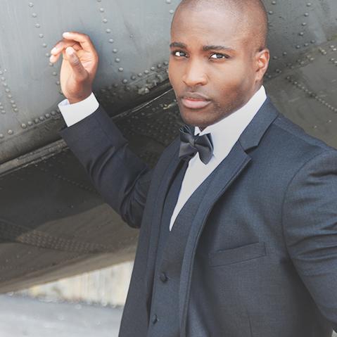 Man in a dark grey tuxedo